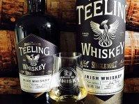 Photo of Teeling Single Malt Irish whiskey and a Glencairn glass